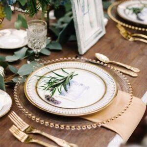 Przezroczysty szklany pod talerz  ze złotymi kulkami 32 cm